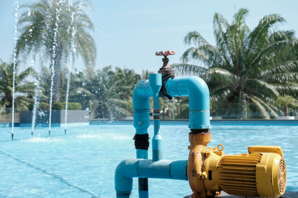 Water pumps are working beside the pool.