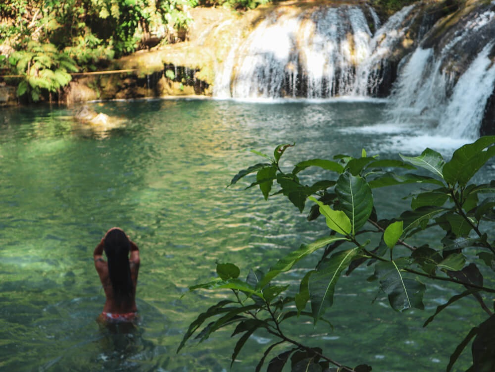 Woman Swimming Alone at the Tropical Wild Nature of Waterfalls