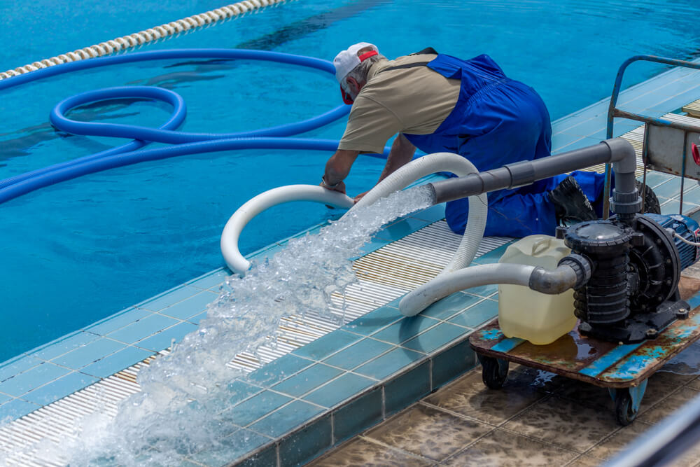 Cleaning the Sports Pool With a Cleaning Water Pump.