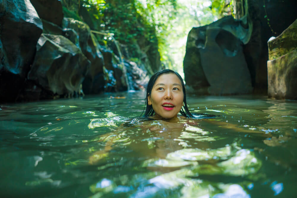 Asian Chinese Woman in Bikini Enjoying Unique Summer Holidays at Tropical Forest Relaxed in Natural Poo