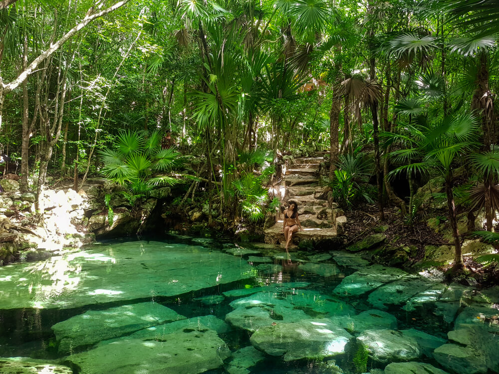 Woman in Natural Swimming Pool Cenote Azul in the Riviera Maya, Yucatan Peninsula
